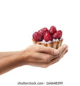 Man hand holding object ( tiny tart with raspberry on top )  isolated on white background. High resolution