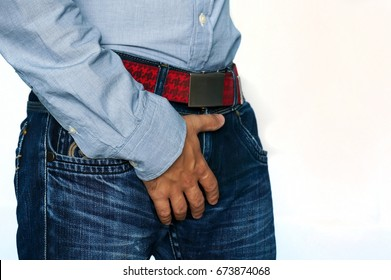 Man hand holding on middle crotch of trousers isolated on white background with copy space