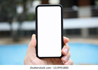 man hand holding phone isolated screen on the background of the pool