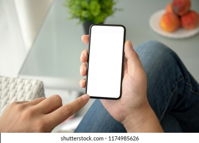 man hand holding phone with isolated screen in room of house