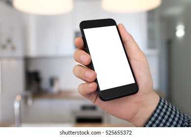 man hand holding phone with isolated screen on background home room kitchen
