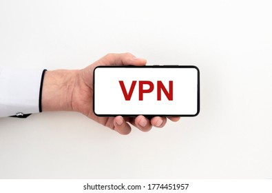 man hand holding phone with text acronym VPN Virtual Private Network