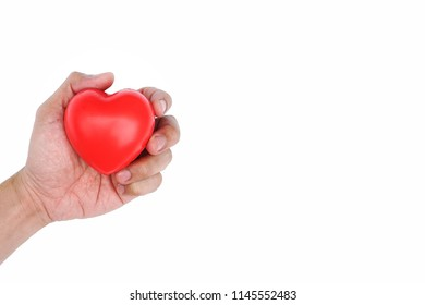 Man Hand holding Red Heart,Concept of Love and Health care,family insurance.World heart day, World health day.Valentine's day.isolated shape of heart on white background.