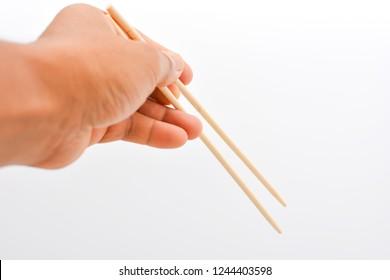 Man Hand holding shopstick isolated on white background.