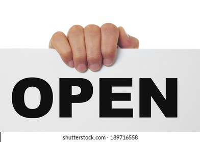 a man hand holding a signboard with the word open written in it