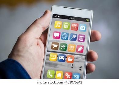 man hand holding smartphone. All screen graphics are made up.