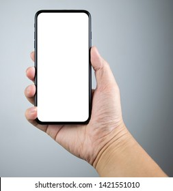 Man hand holding the smartphone full screen with blank screen . isolated on gray background.