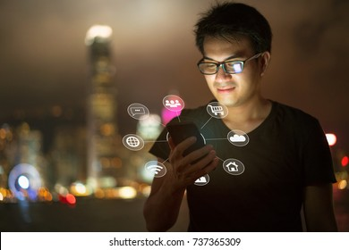 A man hand holding smartphone interface - technology and Social networks icons showing concept