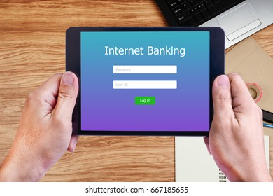 Man hand holding tablet with Internet Banking on screen for Online Payment Technology Concept