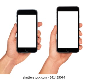 Man hand holding two smartphones in different sizes - blank screen mockup, isolated on white background