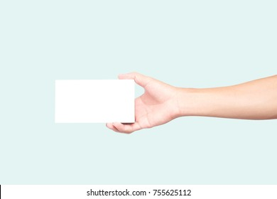 Man hand holding white box on light blue background for text or advertising concept