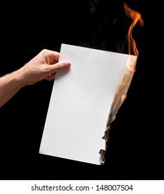 Man hand holding white burned paper