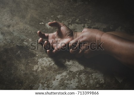 Man hand holding a woman hand for rape and sexual abuse concept