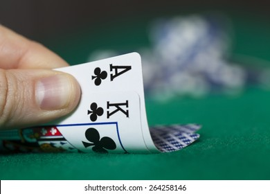 Man Hand Holds Ace with King and Poker Chips