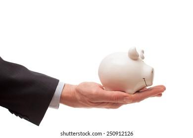 Man hand holds white porcelain pig
