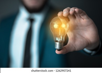 man  hand idea or light bulb