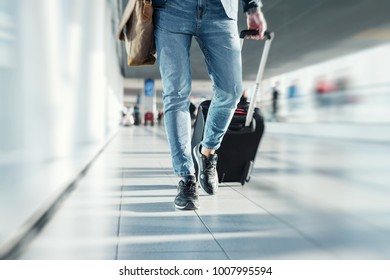 Man with hand luggage walking in airport