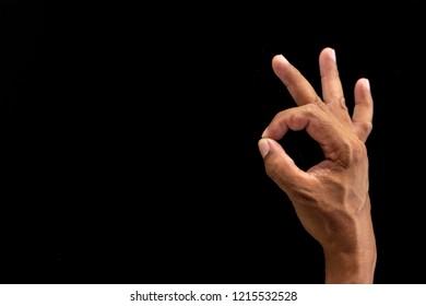 Man hand making Okay or flicking sign
