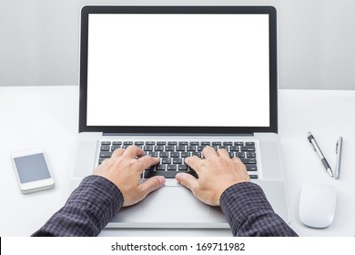 Man hand on laptop keyboard with blank screen monitor