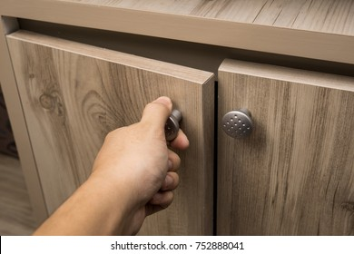 the man  hand open the wood box