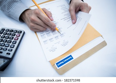 man hand with pen and business report. Accounting