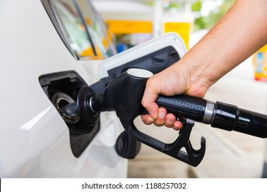 Man hand with petrol pump buying gasoline