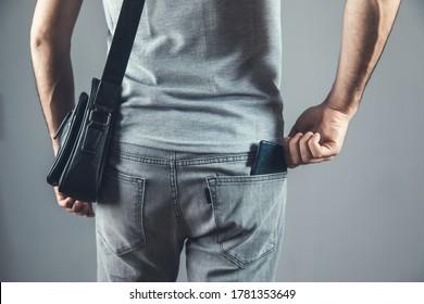 man hand phone on pocket on grey background