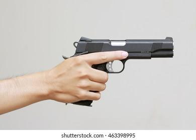 Man hand with pistol handgun weapon