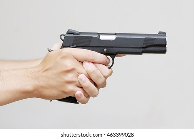 Man hand with pistol handgun weapon