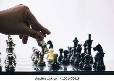man hand plaping chess on checkerboard, concept for business competition