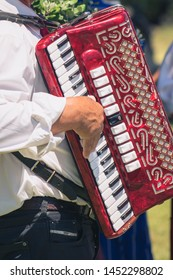 Man hand playing music on the accordion