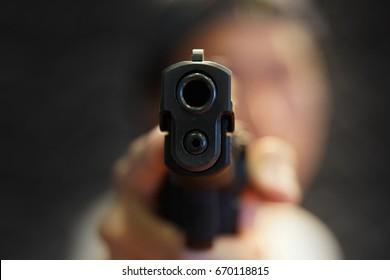 a man hand pointing a gun forward