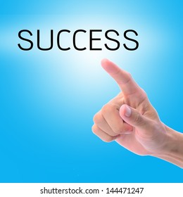 Man hand pointing on word, success, with blue background.