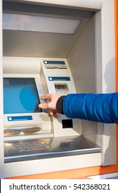 Man hand press button on atm for pin code