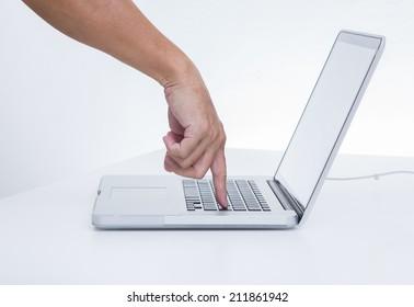 Man hand pressing laptop keyboard