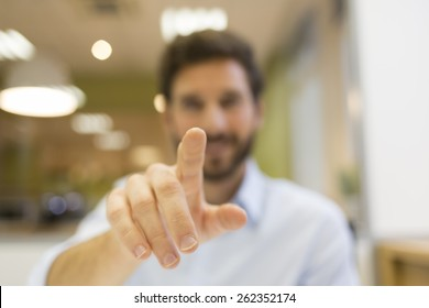 Man hand pushing a digital screen on office background