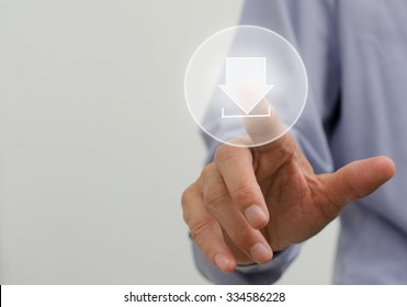 Man hand pushing download icon with virtual screen.