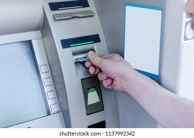 Man hand puts card, press button gray ATM. Technology of business. Banking system. Inflation.