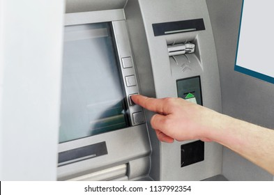 Man hand puts card, press button gray ATM. Private business. Financial system. Modern technologies. Receiving a profit.