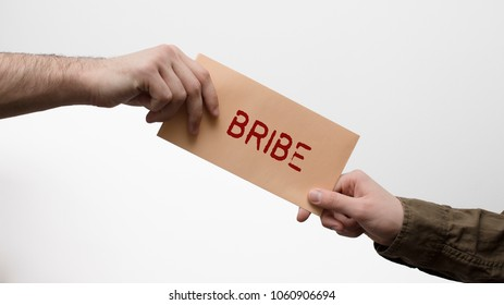 Man hand receiving and giving bribe in envelope. Venality, corruption scam and crime concept