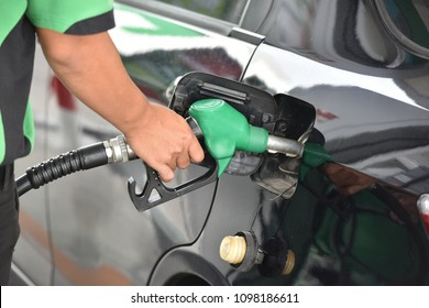 Man hand refuelling the car, Pumping gasoline fuel in car at petrol station.