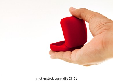 man hand and ring box on white background