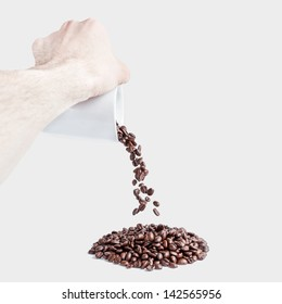 Man hand scattering a cup of coffee with grains
