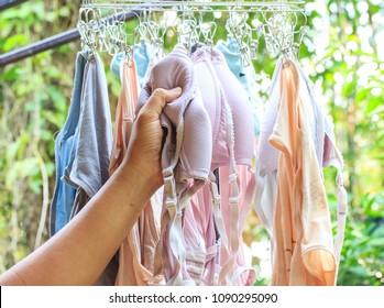 Man hand steal underwear Lady.