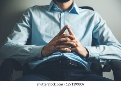 man hand talking in office