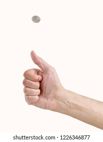 Man hand tossing a coin isolated on white