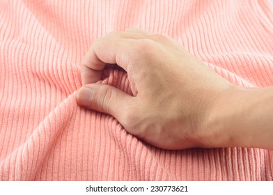 man hand touching cotton fabric textile background