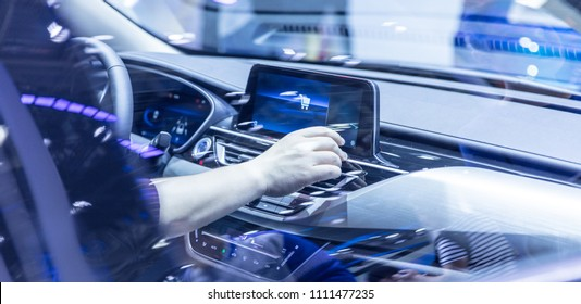Man hand touching to multimedia system with app personal assistant on screen in car