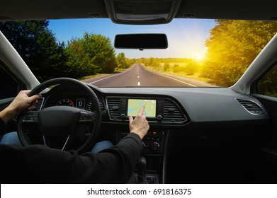 Man hand using GPS navigation inside car