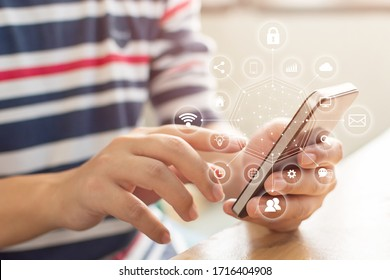 Man hand using smartphone with icon technology communication and internet of things (IOT). Innovative convenience smart life concept